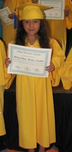 Monica received her diploma for graduating kindergarten