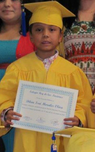Dilan receiving his diploma for kindergarten